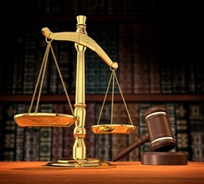 gavel and scales of justice in front of legal books